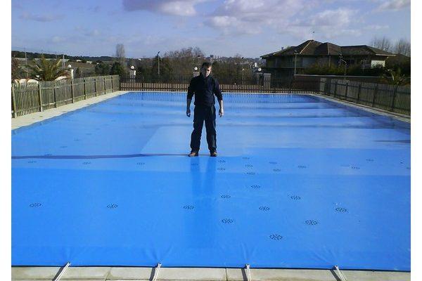 Lona de invierno madrid venta lonas y cobertores para for Cobertor de piscina automatico